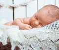 Sleeping newborn baby cute on fluffy lace scarf Royalty Free Stock Images