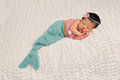 Sleeping Newborn Baby Girl in a Mermaid Costume Royalty Free Stock Photo