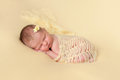 Sleeping Newborn Baby Girl Swaddled in Yellow Royalty Free Stock Photo
