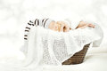 Sleeping newborn baby in hat lying in basket Royalty Free Stock Photo