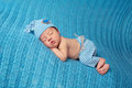 Sleeping Newborn Baby Wearing Striped Pajamas Stock Photography