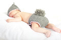 Sleeping newborn in bunny costume baby knitted isolated on white background Stock Image
