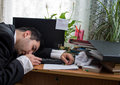 Sleeping office worker with deadline today text on his messy desk on a paper Stock Photography
