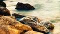 Sleeping sea with coastal rocks abstract natural landscape Stock Image