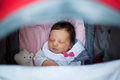 Sleeping in stroller baby crib or seen from above Royalty Free Stock Photos