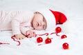 Sleeping sweet baby girl Santa Claus Royalty Free Stock Photo