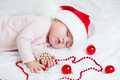 Sleeping sweet baby girl Santa Claus Royalty Free Stock Photo