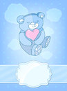 Sleeping teddy bear with a heart in his hands children frame Stock Photo
