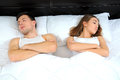 Sleeping upset pair of lovers lying on the bed family conflict Stock Image