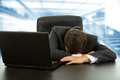 Sleeping young business man on the laptop Stock Images