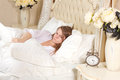 Sleepless woman lying in bed Royalty Free Stock Photo