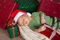 Sleepy christmas baby Stock Photos