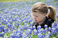 Sleepy girl beautiful little sitting in bluebonnets special needs child sitting getting Royalty Free Stock Image