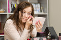Sleepy girl tints the eyelids a young puts makeup in office workplace Royalty Free Stock Photos