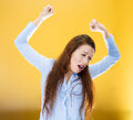 Sleepy lethargic woman closeup portrait pretty beautiful tired fatigued stretching extending arms back shoulders yawning long Royalty Free Stock Photo