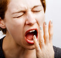 Sleepy tired woman making a big yawn Royalty Free Stock Photo
