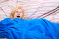 Sleepy woman yawn in a duvet Royalty Free Stock Photography