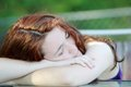 Sleepy women young woman head down asleep pale skin Royalty Free Stock Images