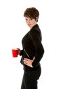 Slender businesswoman wit a cup of coffee over white background Royalty Free Stock Photo