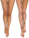 Slender female legs with stretched out feet - front and rear views Royalty Free Stock Photo