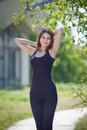Slender girl in black on open air portrait of attractive young woman outdoors Royalty Free Stock Photo