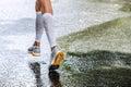 Slender legs of women marathoner in compression socks Royalty Free Stock Photo