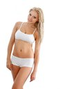 Slender woman wearing white underwear Stock Photos