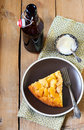 Slice of apple upside down cake with yogurt and bottle of drink Stock Images