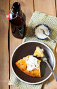 Slice of apple upside down cake with yogurt and bottle of drink Stock Photos