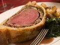 Slice of Beef Wellington with Spinach Stock Images