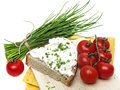 A slice of bread with cheese and chives healthy food Stock Photos