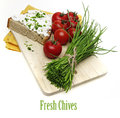 A slice of bread with cheese and fresh chives Royalty Free Stock Photography