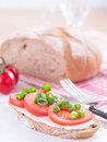 A slice of bread covered with tomatoes and cream cheese Stock Image