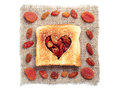 Slice of bread and dried fruit with cut out heart shape with on white background Royalty Free Stock Image