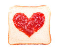 Slice of bread with fruit jam heart shape Royalty Free Stock Image
