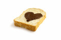 Slice bread with heart shape of chocolate hazelnut spread side view Royalty Free Stock Photo