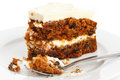 Slice of carrot cake with rich frosting. Royalty Free Stock Photo