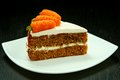 Slice of carrot cake sweet on white plate Stock Photos