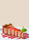 Slice cheesecake with strawberry sauce on white plate and beige background. copy space Royalty Free Stock Photo