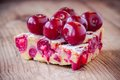 Slice of cherry pie on a wooden background clafoutis rustic Royalty Free Stock Images