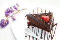 Slice of chocolate layer cake with strawberries and chocolate s Royalty Free Stock Photo