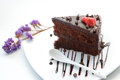Slice of chocolate layer cake with strawberries Royalty Free Stock Photo