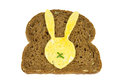 Slice of dark bread with fried egg in Easter Bunny form on it