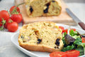 Slice of fresh baked italian bread with tomatoes and olives Stock Photo