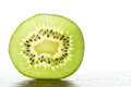 Slice of a fresh kiwi fruit green Stock Photography