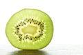 Slice of a fresh kiwi fruit Royalty Free Stock Photo