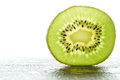 Slice of fresh kiwi fruit green Royalty Free Stock Image
