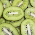 Slice of fresh kiwi healthy fruity food background Stock Photo