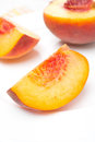 Slice of fresh peach on a plate close up Stock Photo