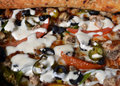 Slice of fresh pizza with vegetables andmeat close up Royalty Free Stock Photo
